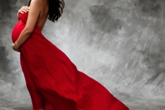 red-flowing-fabric maternity portrait