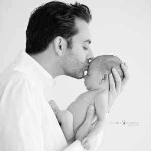 Father and son newborn photo BW
