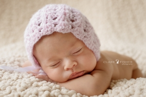 Newborn baby girl with pink bonnet