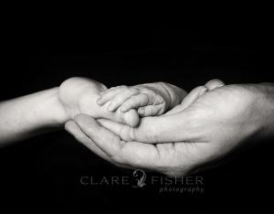 newborn and parent's hands