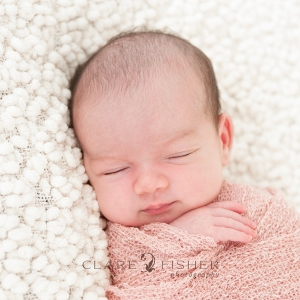 newborn baby's face pink swaddle