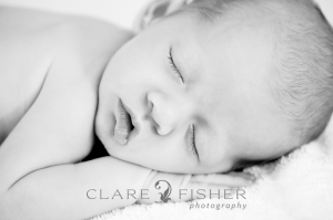 newborn face, black and white