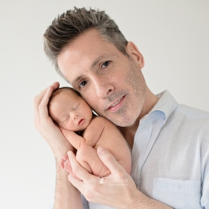 father and tiny baby portrait