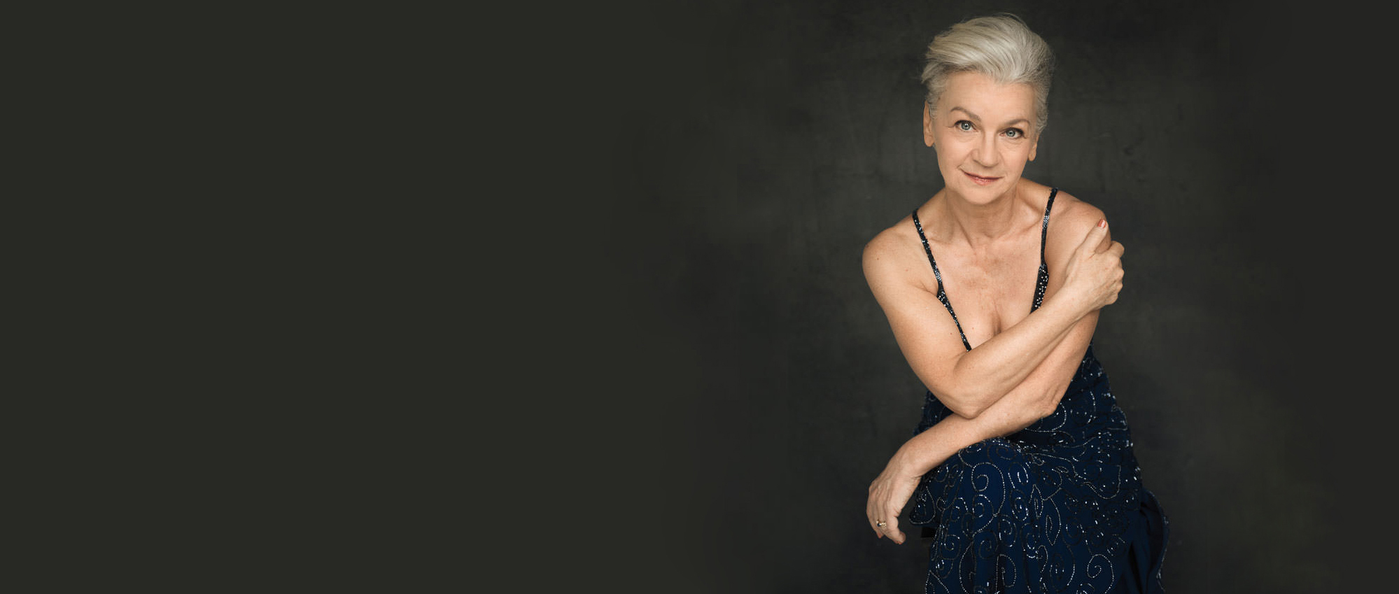portrait of a grey haired woman in an evening dress