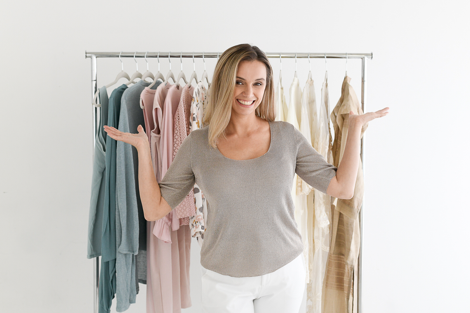 Sava in front of a clothing rack organized in the Kon Mari method