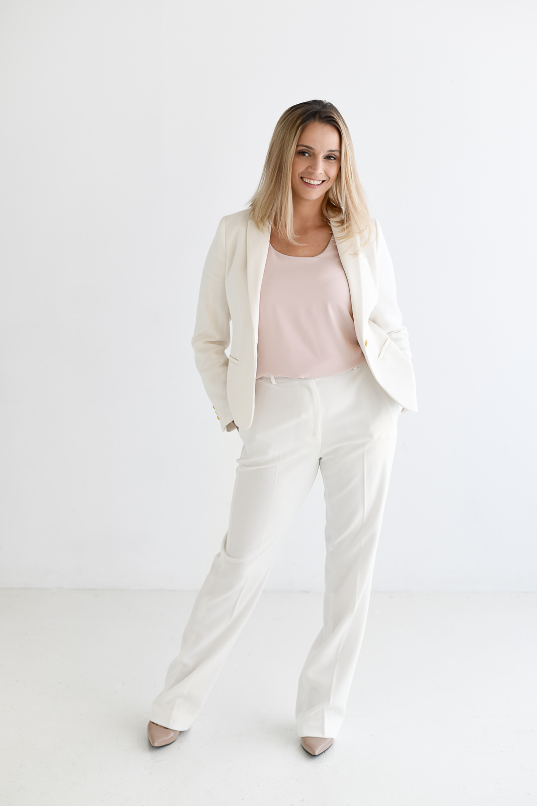Full length image of Sava from Avance Organizing in a white room
