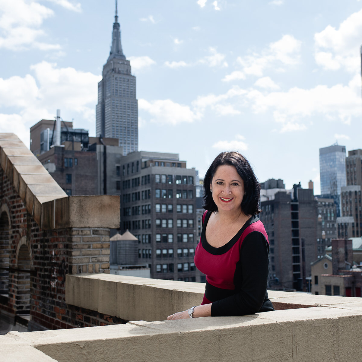 The book midwife with the New York City skyline behind her