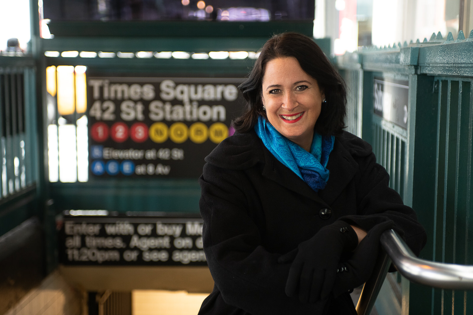 Mindy Gibbins Klein the Book Midwife standing in the entrance to the Times Square subway station