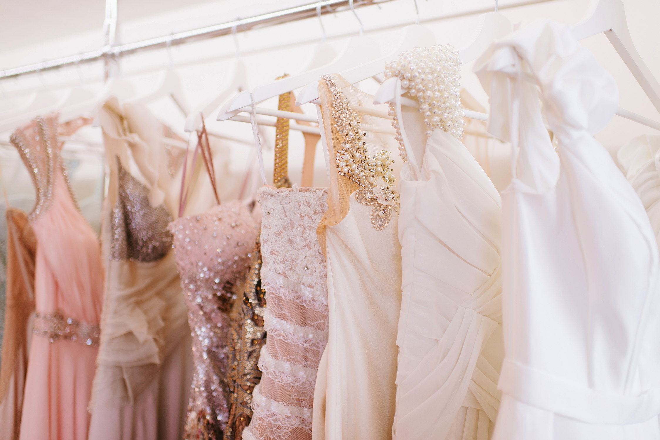 evening dresses hanging on a rack