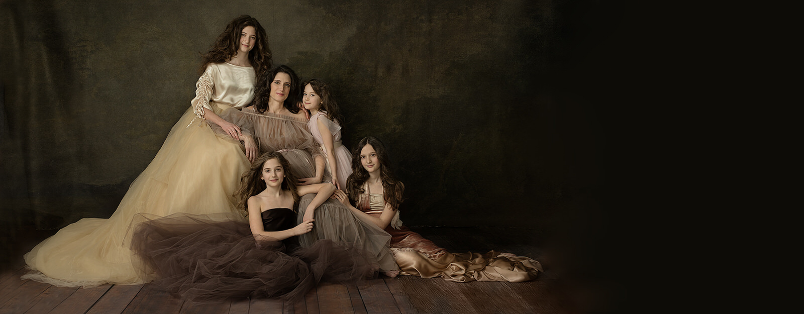 Portrait of a pregnant mother and her four daughters